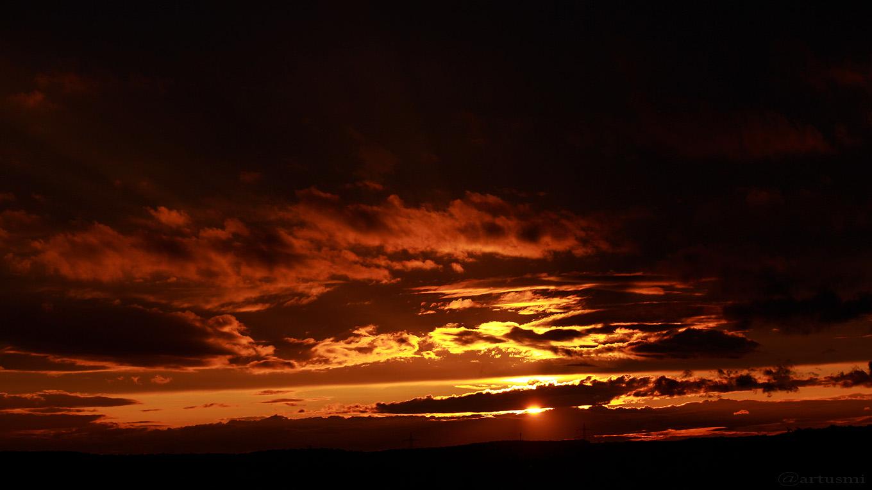Sonnenuntergang am 9. September 2017 um 19:34 Uhr hinter Wolken