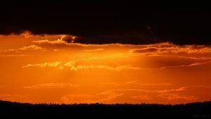 Sonne am 24. September 2018 um 18:58 Uhr hinter Wolken