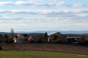Blick über den Huberthof in den Spessart